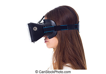 Woman using VR glasses - Young woman in white shirt using...