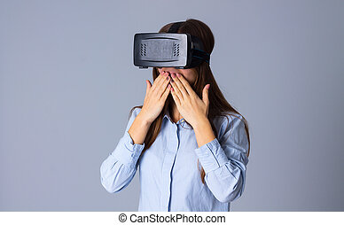 Woman using VR glasses - Young beauiful woman in blue shirt...