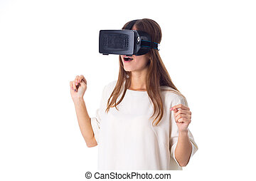 Woman using VR glasses - Surprised young woman in white...