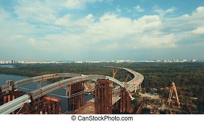 Aerial View of the Massive Bridge Over the River in Linking...