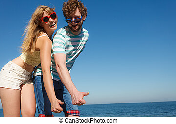Couple friends showing thumb up gesture