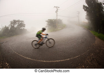 Bicyclist in the Costa Rican cloud forest near Monteverde