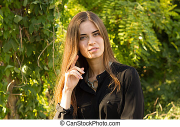 Young woman on the background of trees - Young pretty woman...