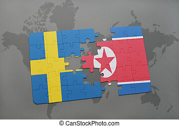 puzzle with the national flag of sweden and north korea on a...