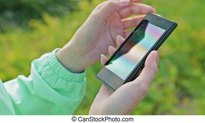Close-Up Woman Using Smart-Phone Outdoors