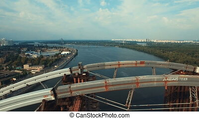 Aerial View of the Massive Bridge Over the River in Linking the Two Shores. the Road is Under Construction, Shot in 4K UHD