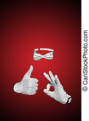 Invisible man figure is posing with white bow tie and gloves...