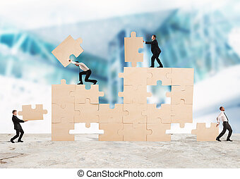 Build the business - Team of businessmen collaborate and...