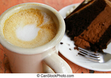 frothy coffee and piece of double chocolate cake