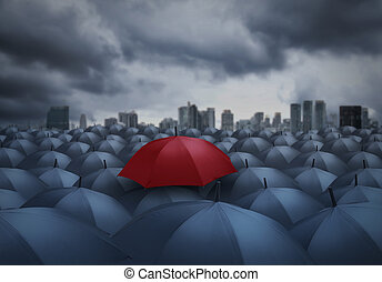 red umbrella outstanding from the others, chosen concept