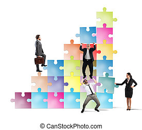 Stair to success - Team holds a puzzle as a scale to climb a...