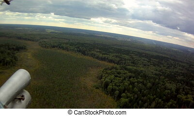 View from helicopter on forest thicket, close-up