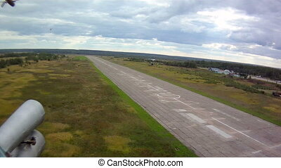 Helicopter flight. Aerial view of runway - Helicopter...