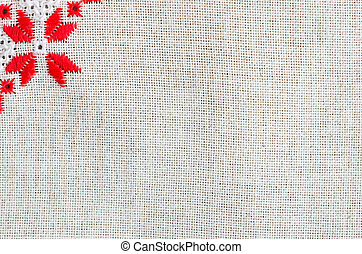 Texture of the vintage homespun linen textile. Background with embroidery.