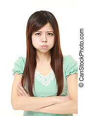 young Japanese woman in a bad mood - portrait of young...