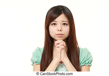 woman folding her hands in prayer
