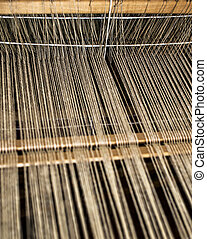 Weaving process - Weaving machine with some fabric.