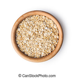 Dry rolled oatmeal. - Dry rolled oatmeal in wooden bowl....