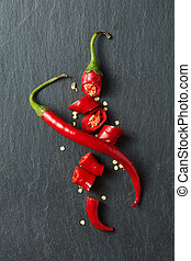 Red chili pepper cut into slices - Red hot chili pepper cut...