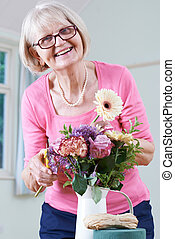 Senior Woman In Flower Arranging Class