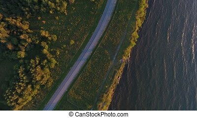 aerial view to cliff, sea and car driving on road - travel,...