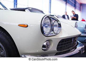 Old cars auction - People viewing cars on sale