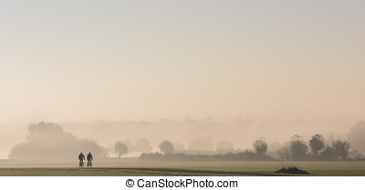 Cyclists in River Forelands - Morning with fog during...