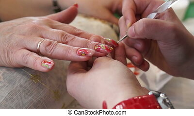 Painting on the nails in the salon