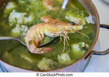 Arroz de Tamboril or soupy seafood rice, portuguese recipe....