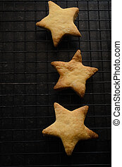 Overhead of Three Star Shaped Christmas Biscuits on Cooling...
