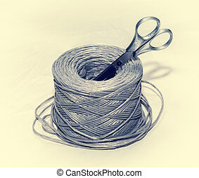 packing rope, scissors - coil of rope and scissors on a...