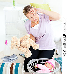 busy mother cleaning bedroom - busy mother cleaning a...
