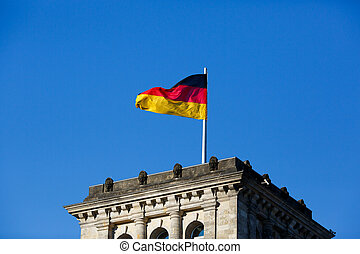 German flag in front of the Reichstag - German Parliament...