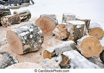Stack of chopped fire woods in the winter