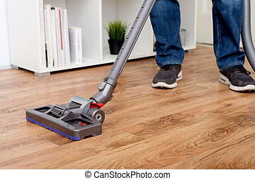Hoovering a parquet floor