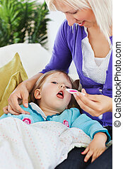 Young woman taking care of her child