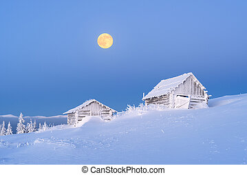 Winter landscape with wooden houses in the frost