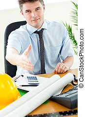 Confident businessman reaching his hand to the camera