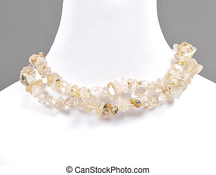 Splintered rutile quartz chain on bust