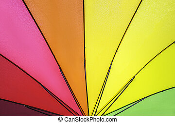 Rainbow colored summer umbrella pattern for background