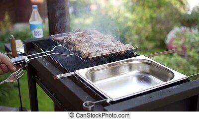 man pulls meat grills, BBQ braizer - man pulls kebab grills,...