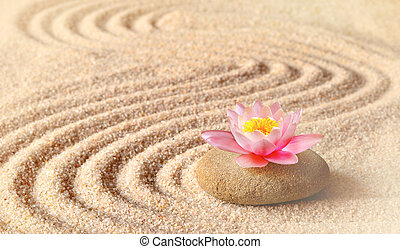 Sand, flower lily and spa stones in zen garden. Spa concept
