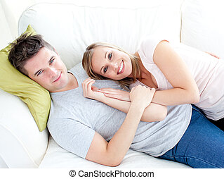 Caress young couple lyingo together on the sofa - Caress...