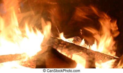Burning logs in fireplace - Closeup of burning logs in...