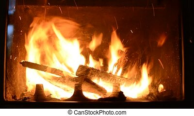 Burning logs in fireplace - Closeup of burning logs in...