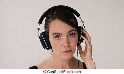 Woman with headphones swaying and smiling