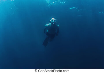 Freediver man swimming in sea - Freediver young man swimming...