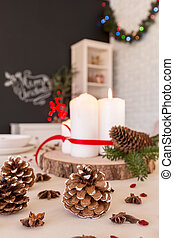 DIY Christmas table decoration with candles and pinecones