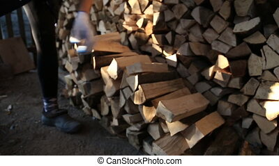 worker puts wood closeup - Worker with gloves adds firewood