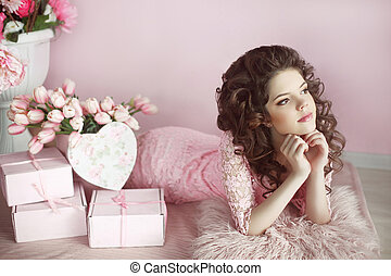 Beautiful teen girl dreaming with curly hair, beauty portrait, romantic surprise